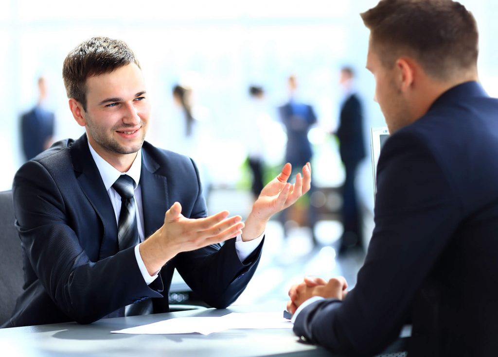 men discussing How to Find Investment Ideas